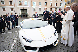 NO FRANCE - NO SWITZERLAND: November 15, 2017 : Pope Francis blesses a Lamborghini donated to him by the luxury sports car maker, at the Vatican.