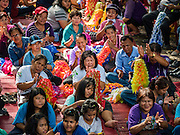 10 SEPTEMBER 2016 - BANGKOK, THAILAND: People listen to musicians perform at a community party in Pom Mahakan in Bangkok. Forty-four families still live in the Pom Mahakan Fort community. The city of Bangkok has given them provisional permission to stay, but city officials say the permission could be rescinded and the city go ahead with the evictions. The residents of the historic fort have barricaded most of the gates into the fort and are joined every day by community activists from around Bangkok who support their efforts to stay.                PHOTO BY JACK KURTZ