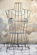 still life of a female metal wire torso for displaying clothing