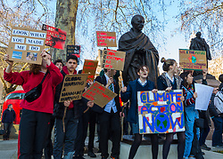 Thousands of schoolchildren gather in Parliament Square, opposite the Hoses of Parliament in London as students across the country strike in protest against climate change. London, February 15 2019.