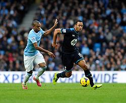 Manchester City's Fernandinho chases down Tottenham Hotspur's Mousa Dembele - Photo mandatory by-line: Dougie Allward/JMP - Tel: Mobile: 07966 386802 24/11/2013 - SPORT - Football - Manchester - Etihad Stadium - Manchester City v Tottenham Hotspur - Barclays Premier League