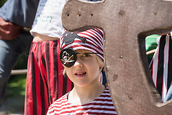 Boy dressed up as pirate in playground, Bavaria, Germany