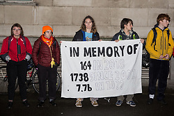 London, UK. 26 November, 2019. Activists from Global Justice Rebellion and London Mining Network protest outside the Mines and Money awards ceremony at the Honorary Artillery Company which is attended by mining company delegates, investors and government representatives. The activists were protesting to highlight the environmental impact of mining and the manner in which mining companies are increasingly attempting to 'greenwash' their activities by claiming that they are indispensable in a transition to sustainables.