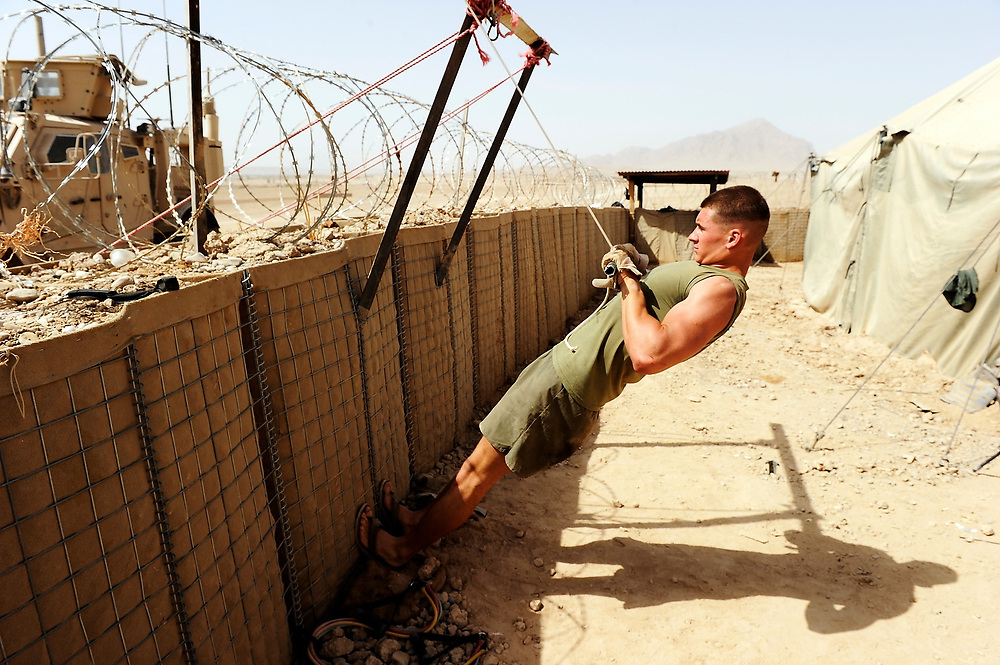 9/7/10 1:08:56 AM -- -- <br /> 1st Battalion, 2nd Marine Regiment, Charlie Company, 1st platoon LCPL Dimitry Bludov working out in a makeshift gym at the marines remote outpost Kunjak near Musa Qala, Helmand Province, Afghanistan in the daytime heat of Helmand Province.<br /> <br /> Photo by Jack Gruber, USA TODAY Staff