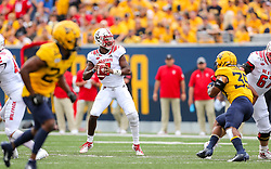 Sep 14, 2019; Morgantown, WV, USA; North Carolina State Wolfpack quarterback Matthew McKay (7) drops back to pass during the first quarter against the West Virginia Mountaineers at Mountaineer Field at Milan Puskar Stadium. Mandatory Credit: Ben Queen-USA TODAY Sports