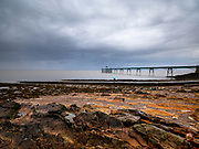 UK Victorian Pier at Clevedon on the Southwest Coast of England on a stormy evening. Licensing and Open Edition Prints.