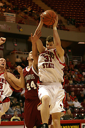 19 November 2005: Jon LaBad attempts to steal away a rebound brought down by Michael Vandello. In a non-conference race that came down to a photo finish, the Illinois State Redbirds slipped past the Indianapolis University Greyhounds 54-50 at Redbird Arena in Normal Illinois