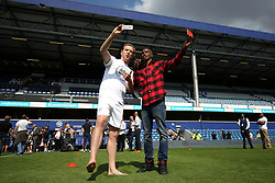 2 September 2017 - Charity Football - Game 4 Grenfell - Damien Lewis and Sir Mo Farah vlog on their phones ahead of kick-off - Photo: Charlotte Wilson
