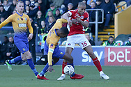 Darren Pratley of Charlton Athletic (17) and Krystian Pearce of Mansfield Town (5) battle for the ball during the The FA Cup match between Mansfield Town and Charlton Athletic at the One Call Stadium, Mansfield, England on 11 November 2018.