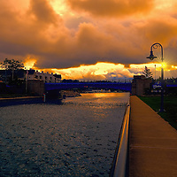"""""""Fire in the Sky over Charlevoix""""<br /> <br /> Amazing sky drama walking in the town of Charlevoix Michigan just after sunrise."""