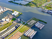 Nederland, Noord-Holland, Amsterdam, 07-05-2021; zicht op IJ en Noordzeekanaal, Coenhaven. Ingang Coentunnel. Petroleumhaven.<br /> View of the IJ and Noordzeekanaal, Coenhaven. Entrance Coentunnel. Petroleum harbor.<br /> <br /> luchtfoto (toeslag op standaard tarieven);<br /> aerial photo (additional fee required)<br /> copyright © 2021 foto/photo Siebe Swart.