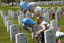 May 27, 2019 - Dayton, Ohio, USA - Teresa Swearingen of Sidney ,Ohio Puts in Balloons over her father grave inside of the Dayton National Cemetery in Dayton Ohio on Memorial Day on Mon May 27,2019.  He Was a member of the US Army and fount in Vietnam and pass away in May of 2010. (Credit Image: © Ernest Coleman/ZUMA Wire)