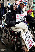 Disabled and able bodied demonstrators chain themselves together and block Oxford Circus in central London. Protesting at the Tory parties Welfare Reform Bill (WRB) which the government plans to make law by May 2012 could leave thousands destitute. It will affect disabled people badly with a cap on benefits and cutting additional support despite promises not to do so.