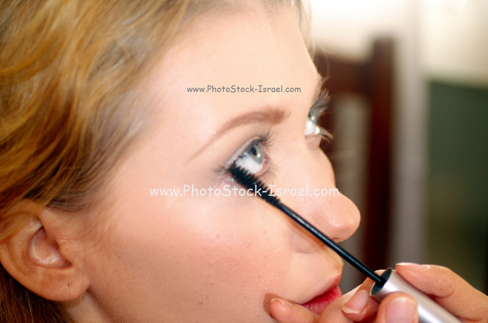 blond model in her 20s with during a make up session MR RF