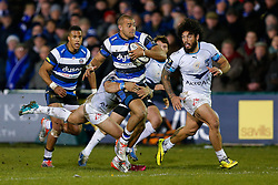 Bath Outside Centre Jonathan Joseph is tackled by Montpellier Inside Centre Wynand Olivier  - Photo mandatory by-line: Rogan Thomson/JMP - 07966 386802 - 12/12/2014 - SPORT - RUGBY UNION - Bath, England - The Recreation Ground - Bath Rugby v Montpellier Herault Rugby - European Rugby Champions Cup Pool 4.