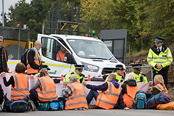 Enfield, UK. 15th September, 2021. Metropolitan Police officers liaise with Insulate Britain climate activists blocking a slip road from the M25 at Junction 25 as part of a campaign intended to push the UK government to make significant legislative change to start lowering emissions. The activists, who wrote to Prime Minister Boris Johnson on 13th August, are demanding that the government immediately promises both to fully fund and ensure the insulation of all social housing in Britain by 2025 and to produce within four months a legally binding national plan to fully fund and ensure the full low-energy and low-carbon whole-house retrofit, with no externalised costs, of all homes in Britain by 2030 as part of a just transition to full decarbonisation of all parts of society and the economy.