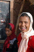 Niger, Agadez, 2007. After some guarded looks, two veiled girls on their way home from school finally relax.