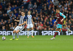 Gareth Barry of West Bromwich Albion receives a pass as Javier Hernandez of West Ham United closes in - Mandatory by-line: Paul Roberts/JMP - 16/09/2017 - FOOTBALL - The Hawthorns - West Bromwich, England - West Bromwich Albion v West Ham United - Premier League