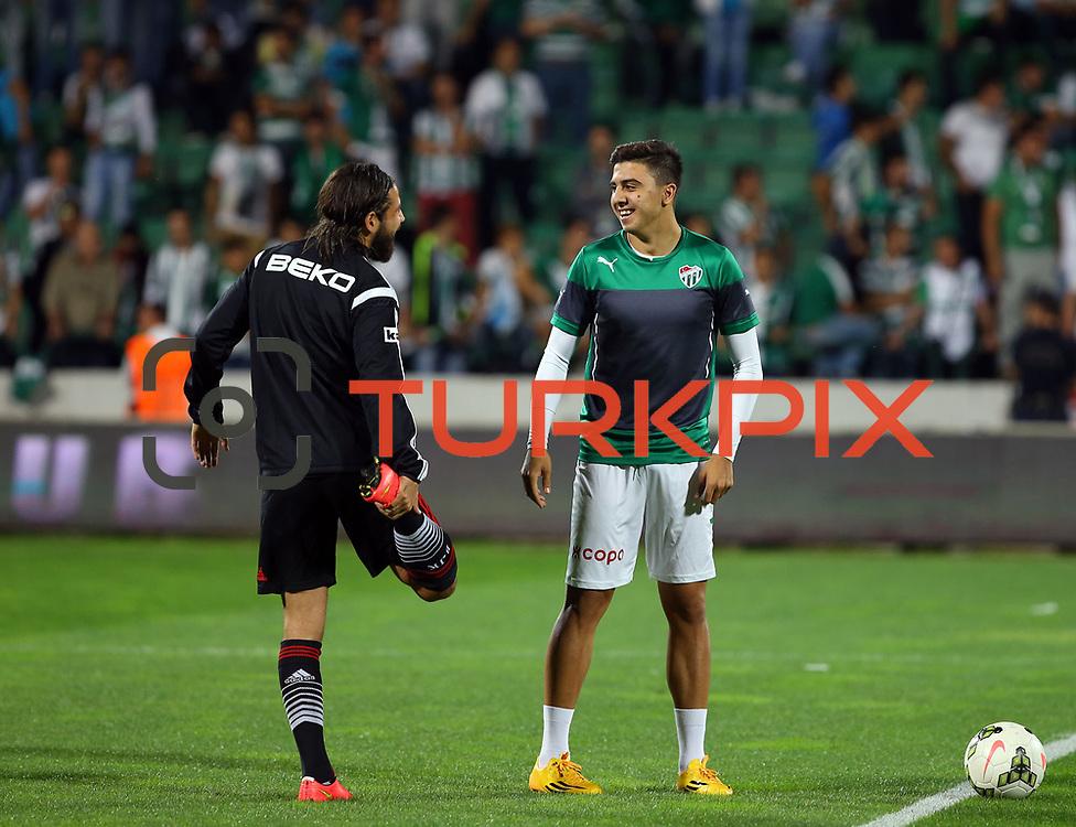 Bursaspor's Ozan Tufan (R) during the Turkish soccer super league match Bursaspor between Besiktas at the Ataturk Stadium in Bursa Turkey on Monday, 22 September 2014. Photo by TURKPIX
