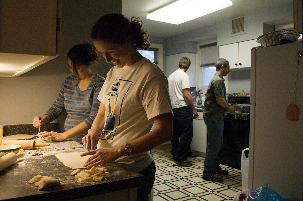 From left: Karen Flipper and Kelly Sadauckas cut dough and fill pierogis while their husbands Jim Sadauckas (left) and Joe Flipper boil them at the Our Lady of Divine Providence parish center, Tuesday, April 13. The pierogis will be sold at the parish festival Sunday, April 1, at Lakefront Brewery. Pierogis are Polish dumplings but are common in Eastern Europe.
