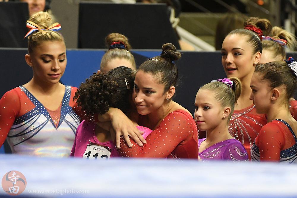 July 10, 2016; San Jose, CA, USA; Aly Raisman (center), Needham, MA, hugs Laurie Hernandez (112), from Old Bridge, NJ, after the women's gymnastics U.S. Olympic team trials at SAP Center.