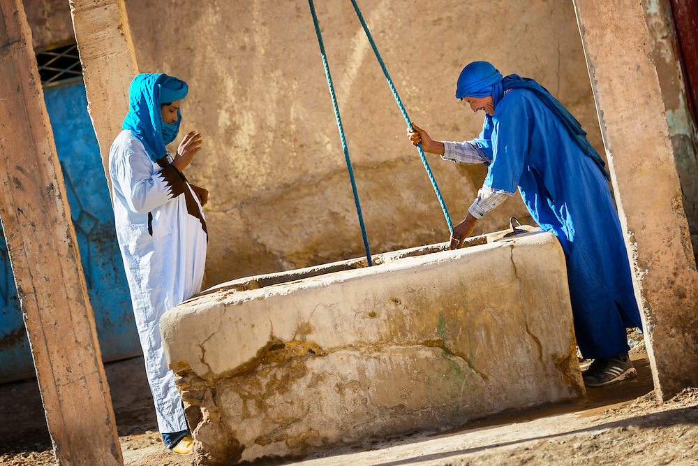 Traditional dressed men at a well, Erfoud, Morocco.