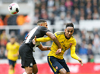 Football - 2019 / 2020 Premier League - Newcastle United vs. Arsenal<br /> <br /> Pierre-Emerick Aubameyang of Arsenal vies with Isaac Hayden of Newcastle United, at St James' Park.<br /> <br /> COLORSPORT/BRUCE WHITE