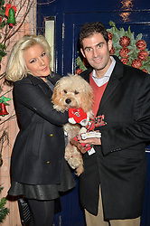NATALIE COYLE and ZAFAR RUSHDIE and their dog Pickle at a recption hosted by the Dogs Trust held at George, 87-88 Mount Street, London on 23rd November 2015.