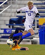 St. Louis University midfielder Sam Rowan (13) leaps over University of Missouri - Kansas City player Cesar Mont Soler as he tries to maintain control of the ball. St. Louis University played the University of Missouri - Kansas City in men's soccer on February 3, 2021 at Robert Hermann Stadium on the SLU campus in St. Louis, MO.<br /> Tim Vizer/For the Post-Dispatch