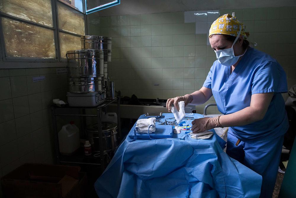 An OR nurse prepares for an operation at St. Elizabeth Hospital in Arusha, Tanzania.