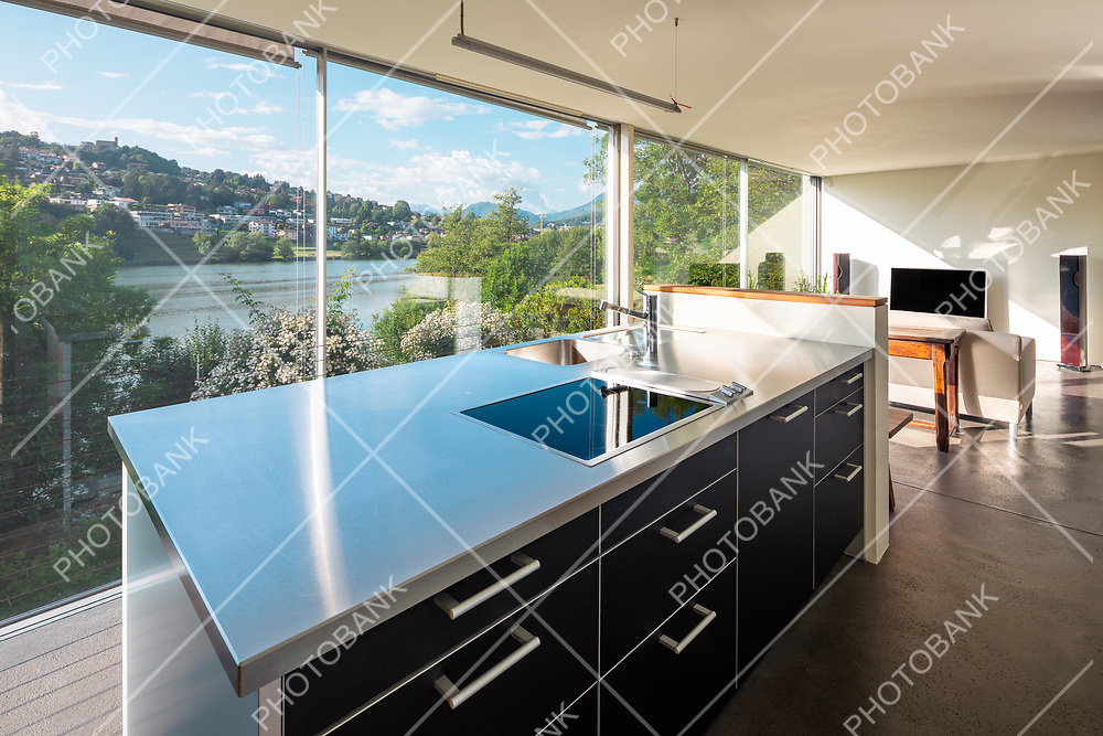 Living room interior with sofa and dream view on a Swiss pond
