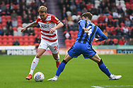 James Coppinger of Doncaster Rovers (26) takes on Alex Lacey of Gillingham (4) during the EFL Sky Bet League 1 match between Doncaster Rovers and Gillingham at the Keepmoat Stadium, Doncaster, England on 20 October 2018.