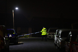 © Licensed to London News Pictures. 18/03/2021. Bury, UK. ***UPDATED CAPTION**F Police close off Lea Mount Drive in Bury after reports of an attack on a car parked in the driveway of a house this evening . Photo credit: Joel Goodman/LNP