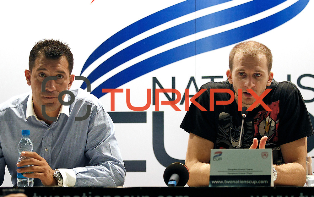 Anadolu Efes's coach Ufuk SARICA (L) and Sinan GULER (R) during their Two Nations Cup basketball match Anadolu Efes between Olympiacos at Abdi Ipekci Arena in Istanbul Turkey on Sunday 02 October 2011. Photo by TURKPIX