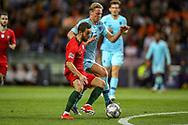 Portugal midfielder Bernardo Silva (10) battles with Netherlands Midfielder Frenkie de Jong (Ajax) during the UEFA Nations League match between Portugal and Netherlands at Estadio do Dragao, Porto, Portugal on 9 June 2019.