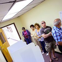 033015  Adron Gardner/Independent<br /> <br /> Voters gather to cast their mayoral run-off ballot at City Hall in Gallup Monday.