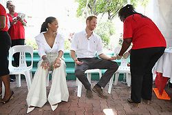 Rihanna (left) and Prince Harry take part in a live HIV test, at the 'Man Aware' event held by the Barbados National HIV/AIDS Commission in Bridgetown, Barbados, during his tour of the Caribbean.