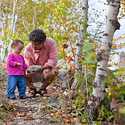 A man and his young daughter on a trail on Millstone Hill in Barre, Vermont. Millstone Trail Association. Abandoned granite quarry.