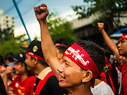 09 NOVEMBER 2015 - YANGON, MYANMAR: A man waits for Aung San Suu Kyi at NLD headquaters Monday. Thousands of National League for Democracy (NLD) supporters gathered at NLD headquarters on Shwegondaing Road in central Yangon to celebrate their apparent landslide victory in Myanmar's national elections that took place Sunday. The announcement of official results was delayed repeatedly Monday, but early reports are that the NLD did very well against the incumbent USDP.     PHOTO BY JACK KURTZ