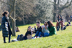 © Licensed to London News Pictures 27/02/2021.        Greenwich, UK. People relaxing in the sun during a third national Coronavirus lockdown in Greenwich Park, London. Photo credit:Grant Falvey/LNP