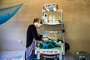 Dr Siobhan Neville examines a very sick baby who has just been delivered by cesarian section, NICU (Neonatal Intensive Care Unit) ward. St Walburg's Hospital, Nyangao. Lindi Region, Tanzania.