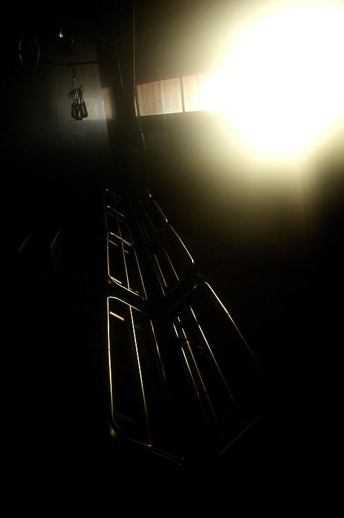 Hirvas Salmi, FINLAND. October 20, 2007-Light reflects off a slaughterhouse conveyor belt.