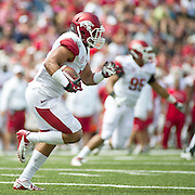 Apr 20, 2013; Fayetteville, AR, USA; Arkansas Razorback white safety Tiquention Coleman (7) returns an interception during the red vs. white spring football game at Donald W. Reynolds Razorback Stadium. Mandatory Credit: Beth Hall-USA TODAY Sports