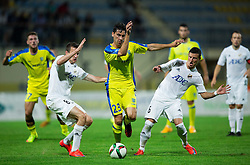 Horvat Lucas Mario of NK Domzale between Jankovic Branislav of FK Cukaricki and Srnic Dragoljub of FK Cukaricki during 1st Leg football match between NK Domzale (SLO) na FC Cukaricki (SRB) in 1st Round of Europe League 2015/2016 Qualifications, on July 2, 2015 in Sports park Domzale,  Slovenia. Photo by Vid Ponikvar / Sportida