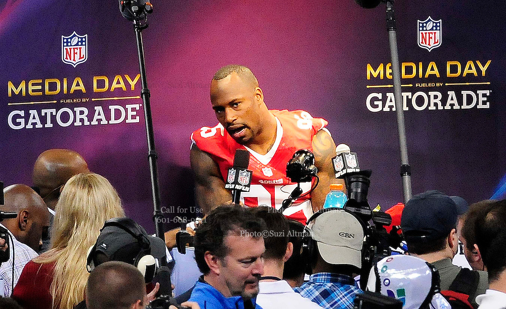 1/29/13 New Orleans LA.-San Francisco TE Vernon Davis speaks to the world press at Super Bowl XLV11 Media Day at the the Mercedes Benz Super Dome for the NFC champion San Francisco 49ers's and the AFC Champions  Baltimore Ravens  prior to Super Bowl XLV11 in New Orleans. Photo©Suzi Altman