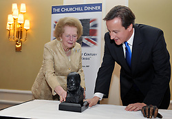 Leader of the Conservative Party David Cameron  presents  a bust of Winston Churchill  to Baroness Thatcher for  The Churchill Centre award for Statesmanship  in Central London ,Tuesday  October 20 , 2009 .Photo By Andrew Parsons ..