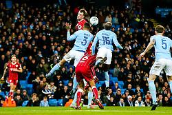 Aden Flint of Bristol City is challenged by Danilo and Eliaquim Mangala of Manchester City - Rogan/JMP - 09/01/2018 - Etihad Stadium - Manchester, England - Manchester City v Bristol City - Carabao Cup Semi Final First Leg.