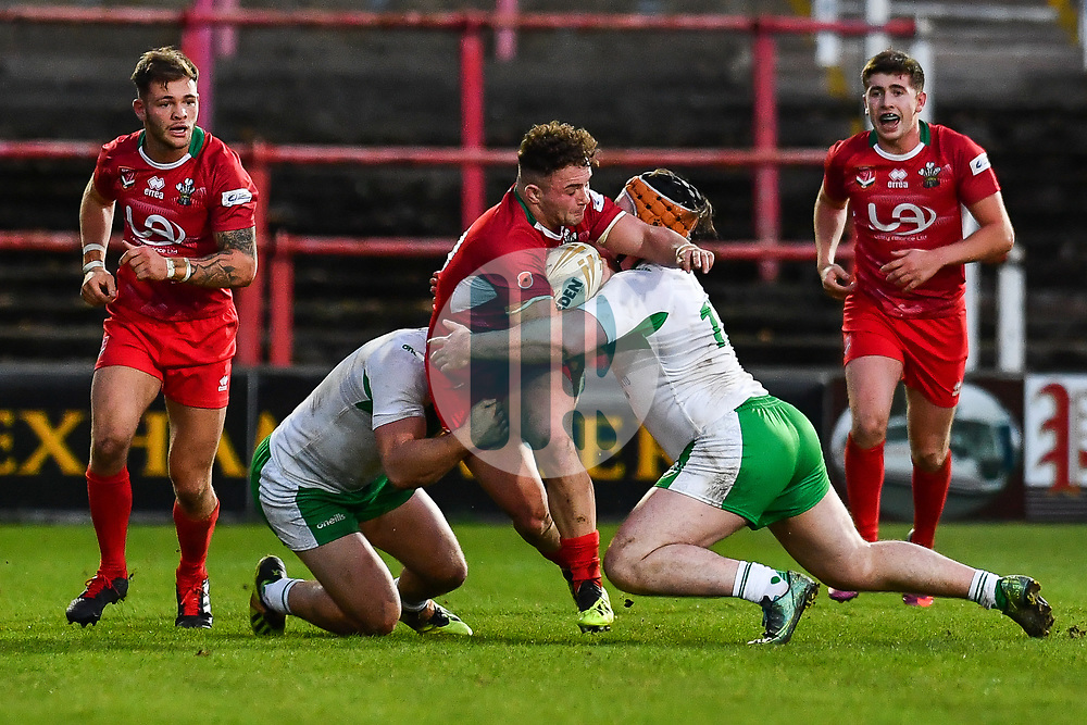 11th November 2018 , Racecourse Ground,  Wrexham, Wales ;  Rugby League World Cup Qualifier,Wales v Ireland ; Curtis Davies of Wales is tackled by Michael Ward and George King of Ireland <br /> <br /> <br /> Credit:   Craig Thomas/Replay Images