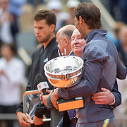 PARIS, FRANCE June 09.   Rafael Nadal of Spain holds the winners trophy and is embraced by tennis legend Rod Laver after his victory against Dominic Thiem of Austria during the Men's Singles Final on Court Philippe-Chatrier at the 2019 French Open Tennis Tournament at Roland Garros on June 9th 2019 in Paris, France. (Photo by Tim Clayton/Corbis via Getty Images)