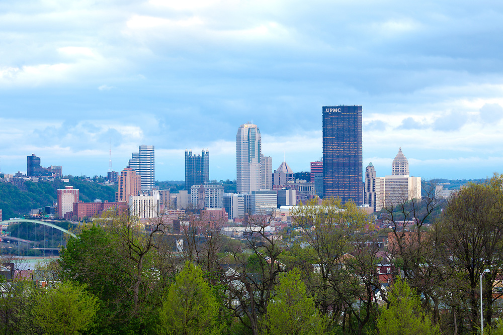 Pittsburgh, Pennsylvania, United States - Schenley Park at Oakland neighborhood and downtown city skyline.